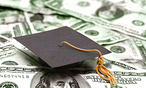 small graduation cap and money -- educational cost concept